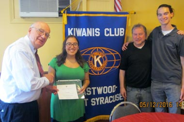 Ernie Wass presents a certificate of appreciation to Natalie Rodrigues, Simon Morrin and Jeremy Driscoll.